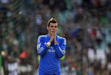 Real Madrid's Bale reacts after missing a scoring opportunity against Real Betis during a soccer match in Seville