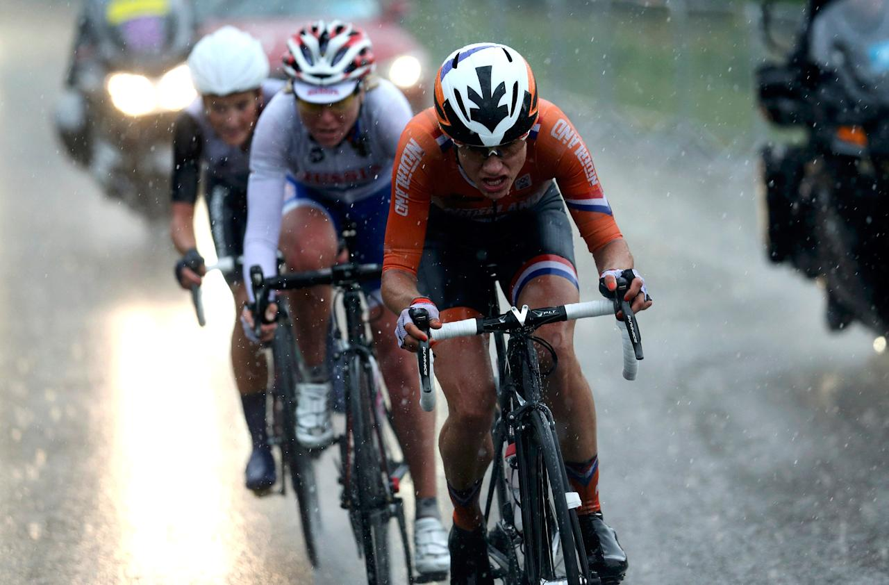 LONDON, ENGLAND - JULY 29:  Olga Zabelinskaya (C) of Russia, Elizabeth Armitstead (L) of Great Britain and Marianne Vos (R) of Netherlands break away from the pack during the Women's Road Race Road Cycling Day 2 of the London 2012 Olympic Games on July 29, 2012 in London, England. (Photo by Stefano Rellandini - IOPP Pool Getty Images)