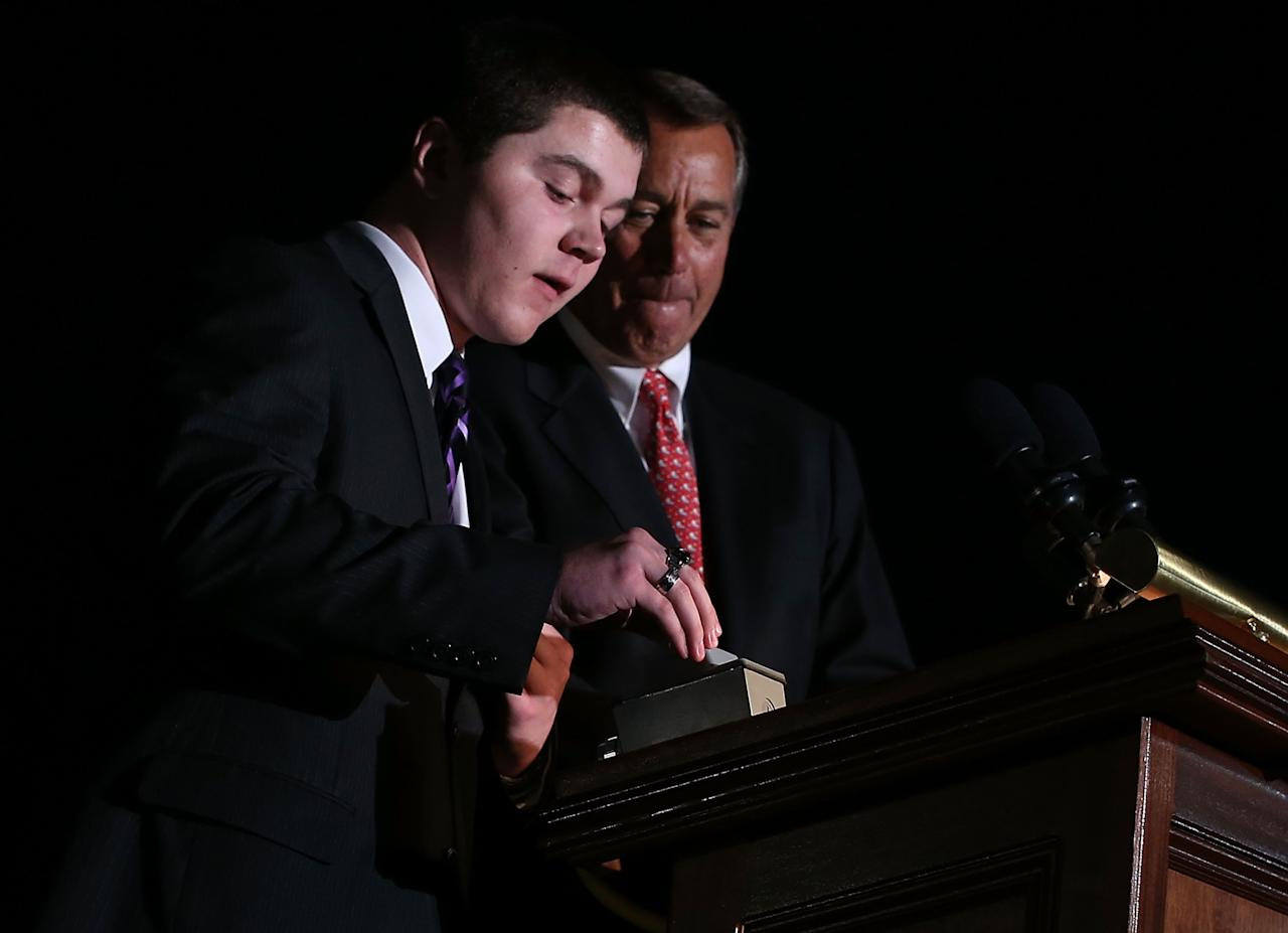 WASHINGTON, DC - DECEMBER 04:  U.S. Speaker of the House Rep. John Boehner (R-OH) (R) lights up the 2012 Capitol Christmas Tree with Ryan Shuster (L), a senior at Discovery Canyon Campus in Colorado Spring, Colorado, December 4, 2012 at the West Front Lawn of the U.S. Capitol in Washington, DC. The year's tree is a 65-foot Engelmann spruce from the Blanco Ranger District of the White River National Forest in Colorado.  (Photo by Alex Wong/Getty Images)