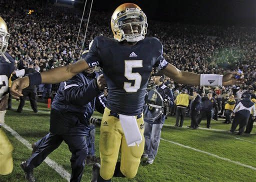 Notre Dame quarterback Everett Golson celebrated after scoring the winning touchdown in the the third overtime period against Pittsburgh in an NCAA college football game in South Bend, Ind., Saturday, Nov. 3, 2012. Dame defeated Pittsburgh 29-26 in triple overtime. (AP Photo/Michael Conroy)