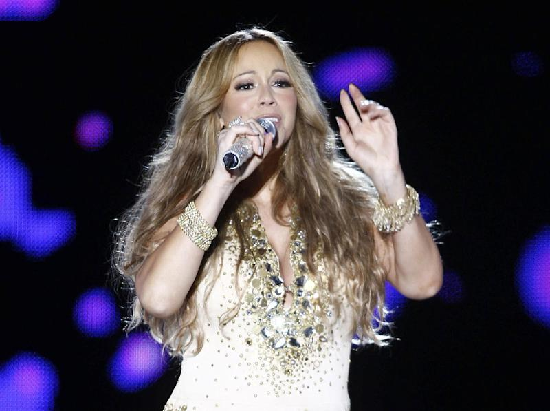 """FILE - This May 26, 2012 file photo shows U.S. Singer Mariah Carey performing on stage during a concert at the Mawazine Festival in Rabat, Morocco. Carey will be joining the cast of """"American Idol.""""  She told a meeting of the Television Critics Association that she is excited to join as a judge and it all happened quickly. (AP Photo/Abdeljalil Bounhar, file)"""
