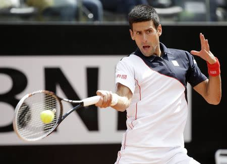 Djokovic of Serbia hits a return to Stepanek of Czech Republic during their men's singles match at the Rome Masters tennis tournament