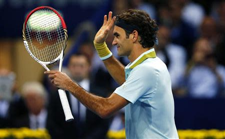 Switzerland's Federer reacts after winning his match against Mannarino of France at the Swiss Indoors ATP tennis tournament in Basel