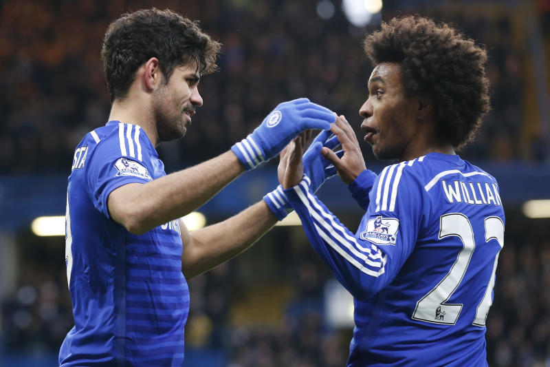 Chelsea's Diego Costa (L) celebrates with midfielder Willian (R) after scoring their second goal during the English Premier League football match between Chelsea and West Ham United at Stamford Bridge in London on December 26, 2014