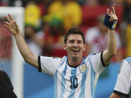 Argentina's Messi celebrates his team's win over Belgium after their 2014 World Cup quarter-finals at the Brasilia national stadium in Brasilia