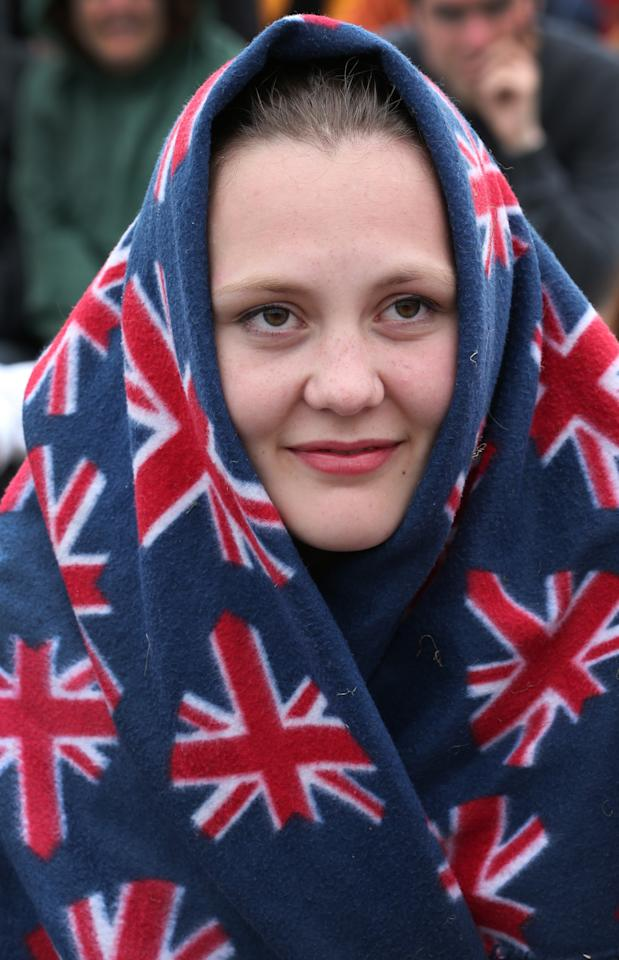 LONDON, ENGLAND - JUNE 27: A spectator waits for play to resume wrapped in a Union flag decorated blanket on day four of the Wimbledon Lawn Tennis Championships at the All England Lawn Tennis and Croquet Club on June 27, 2013 in London, England. Play has been disrupted on some courts due to rain. (Photo by Peter Macdiarmid/Getty Images)