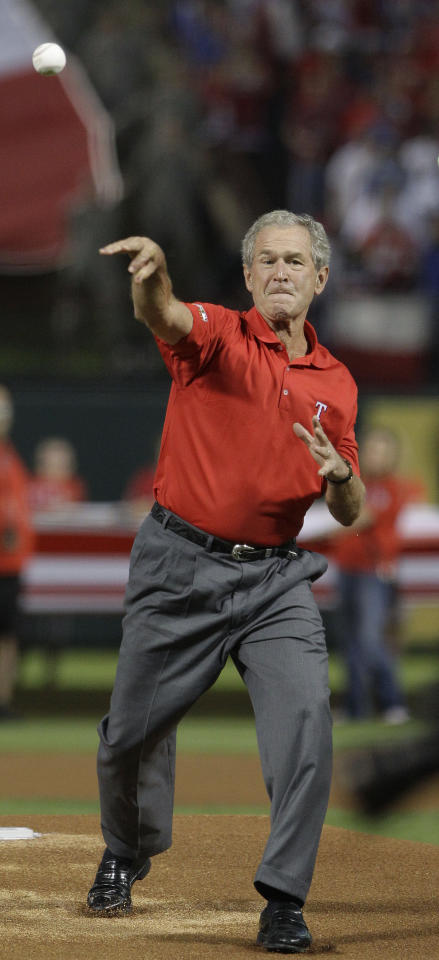 Former President George W. Bush throws out the ceremonial first pitch before Game 4 of baseball's World Series between the St. Louis Cardinals and the Texas Rangers Sunday, Oct. 23, 2011, in Arlington, Texas. (AP Photo/Tony Gutierrez)