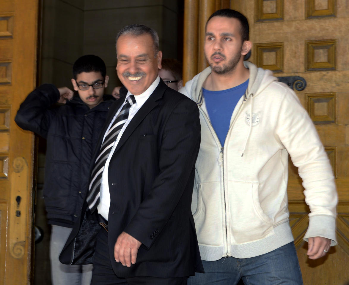Family members of Raed Jaser, including father Mohammed Jaser, center, leave court in Toronto on Tuesday, April 23, 2013. Raed Jaser, accused with another of plotting to derail a train in Canada with support from al-Qaida elements in Iran, made a brief court appearance and was told to appear in court again next month. (AP Photo/The Canadian Press, Frank Gunn)
