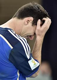 Lionel Messi goes to get his runner-up medal after the World Cup final. (AP)