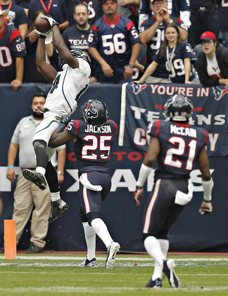 HOUSTON, TX - NOVEMBER 18: Justin Blackmon #14 of the Jacksonville Jaguars goes up for a pass over Kareem Jackson #25 of the Houston Texans at Reliant Stadium on November 18, 2012 in Houston, Texas. Houston wins 43-37 in overtime. (Photo by Bob Levey/Getty Images)