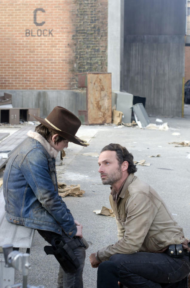 "Carl Grimes (Chandler Riggs) and Rick Grimes (Andrew Lincoln) in ""The Walking Dead"" Season 3 Finale, ""Welcome to the Tombs."""