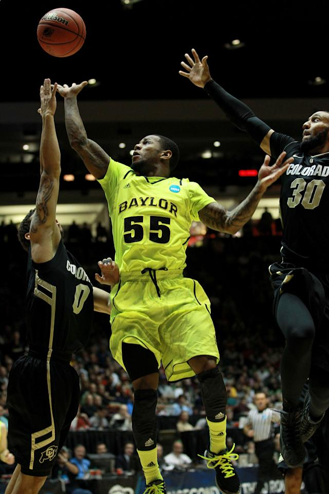ALBUQUERQUE, NM - MARCH 17:  Pierre Jackson #55 of the Baylor Bears shoots against Askia Booker #0 and Carlon Brown #30 of the Colorado Buffaloes in the first half during the third round of the 2012 NCAA Men's Basketball Tournament at The Pit on March 17, 2012 in Albuquerque, New Mexico.  (Photo by Ronald Martinez/Getty Images)
