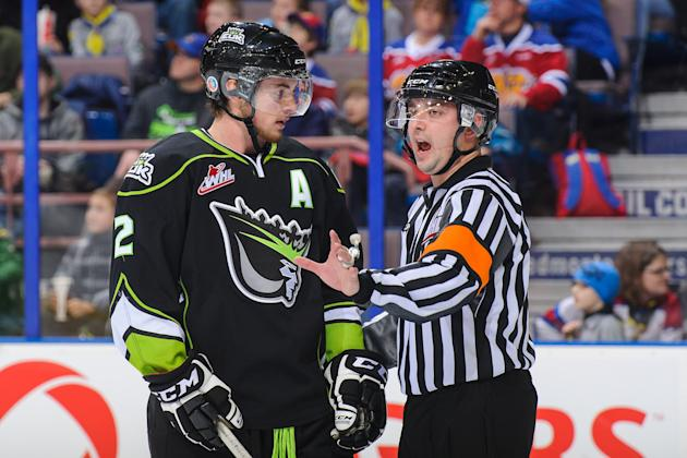 Cody Corbett #2 of the Edmonton Oil Kings discusses a call with an official between play against the Calgary Hitmen. (Photo by Derek Leung/Getty Images)