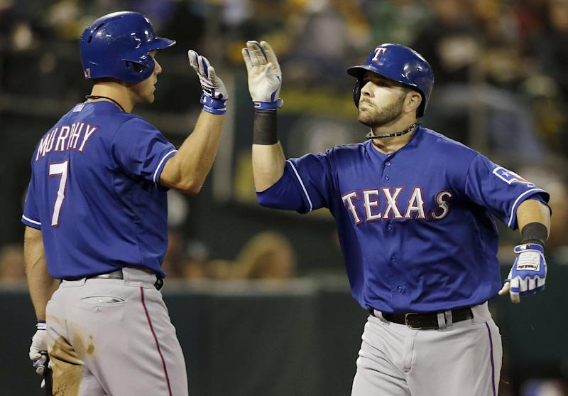 Rangers beat A's 5-1 for sole possession of 1st