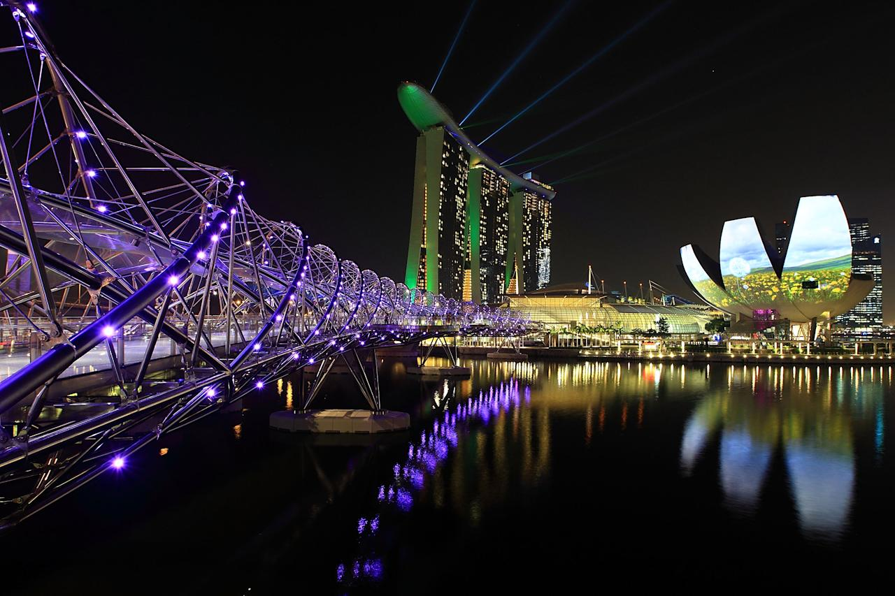 SINGAPORE - MARCH 28:  A general view of the Helix Bridge, Marina Bay Sands, ArtScience Museum and the city skyline on March 28, 2012 in Singapore. Singapore expects a slowdown in tourist arrival, with a forecast growth of 2.3 percent in 2012 as compared to 13 percent in 2011, according to the local media.  (Photo by Suhaimi Abdullah/Getty Images)