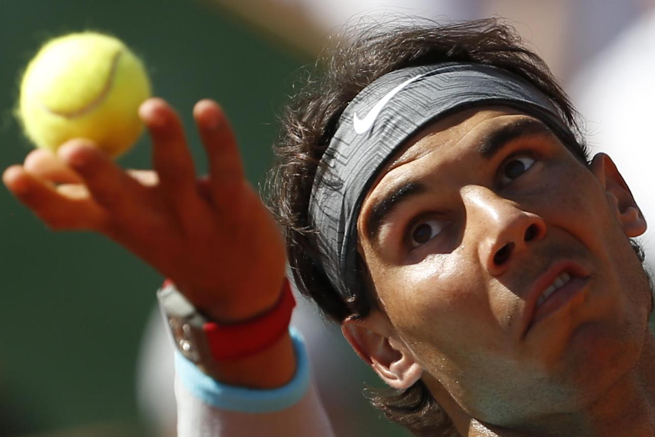 Spain's Rafael Nadal serves the ball during the semifinal match of the French Open tennis tournament against Britain's Andy Murray at the Roland Garros stadium, in Paris, France, Friday, June 6, 2014. (AP Photo/Darko Vojinovic)
