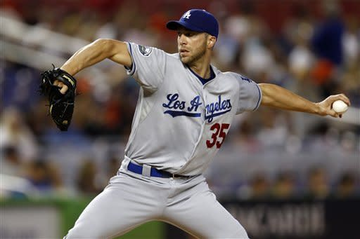 Capuano holds Miami hitless until 7th, Dodgers win