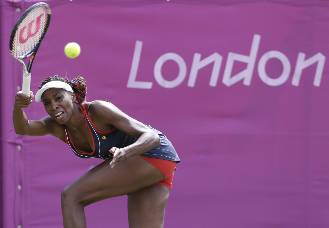 Venus Williams of the United States returns to Sara Errani of Italy at the All England Lawn Tennis Club in Wimbledon, London at the 2012 Summer Olympics, Monday, July 30, 2012. (AP Photo/Elise Amendola)