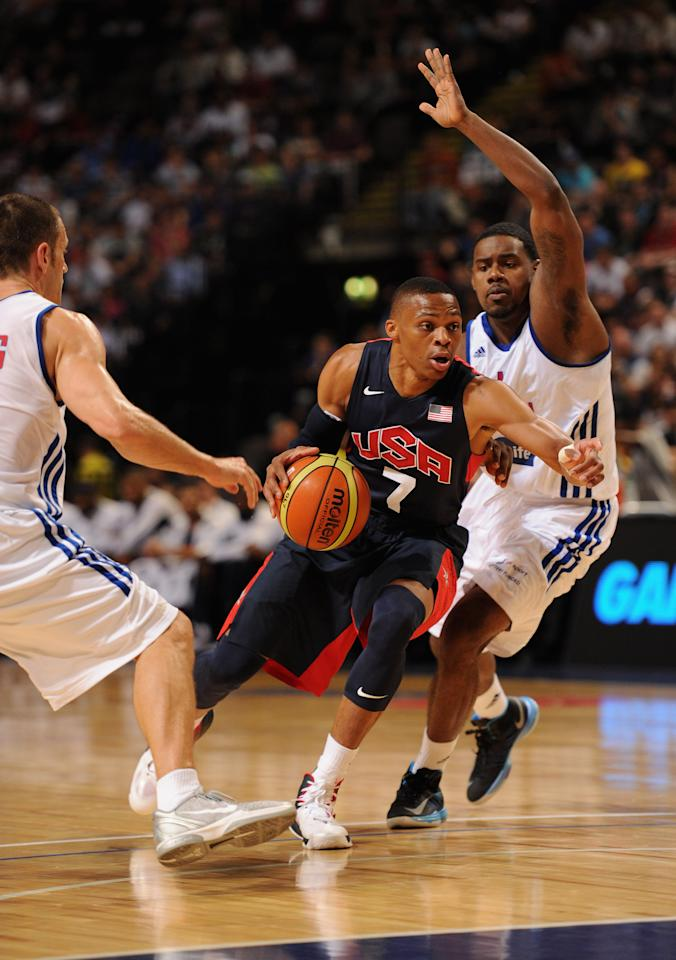 MANCHESTER, ENGLAND - JULY 19:  USA player Russell Westbrook (c) in action during the Men's Exhibition Game between USA and Team GB at Manchester Arena on July 19, 2012 in Manchester, England.  (Photo by Stu Forster/Getty Images)