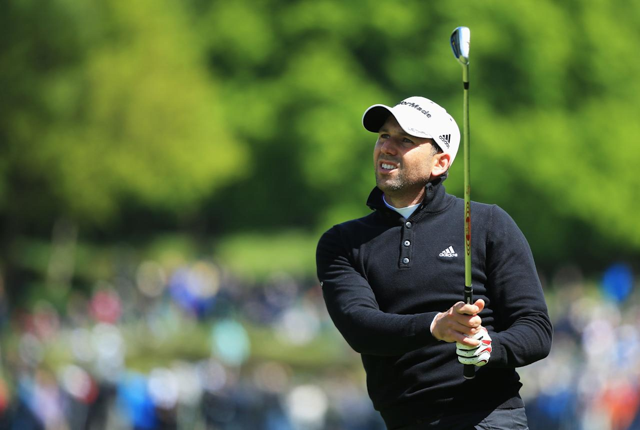 VIRGINIA WATER, ENGLAND - MAY 23:  Sergio Garcia of Spain hits his second shot on the 6th during the first round of the BMW PGA Championship on the West Course at Wentworth on May 22, 2013 in Virginia Water, England.  (Photo by Richard Heathcote/Getty Images)