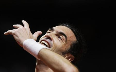 Bruguera of Spain reacts during his final match against Courier of the U.S. at the Masters Senior tennis tournament in Madrid