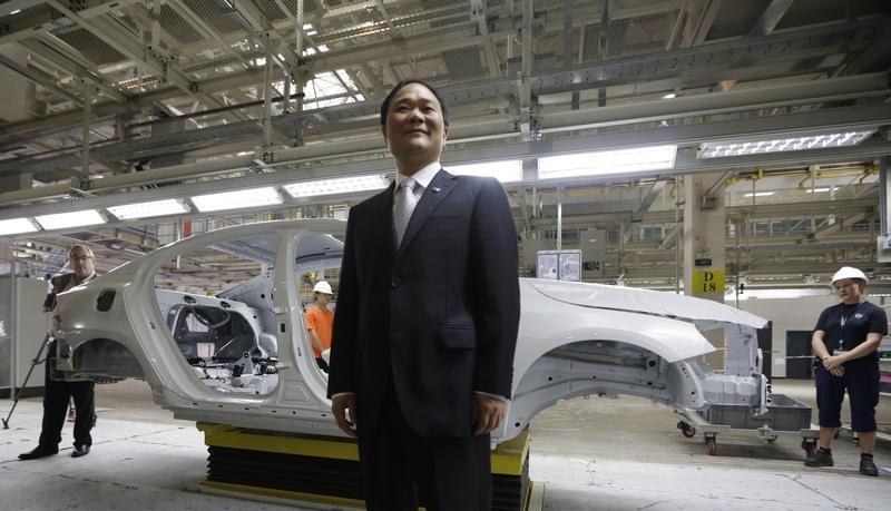 Chairman of Zhejiang Geely Holding Group Li Shufu poses for a photo at an assembly line of the new Volvo automobile manufacturing plant in Chengdu