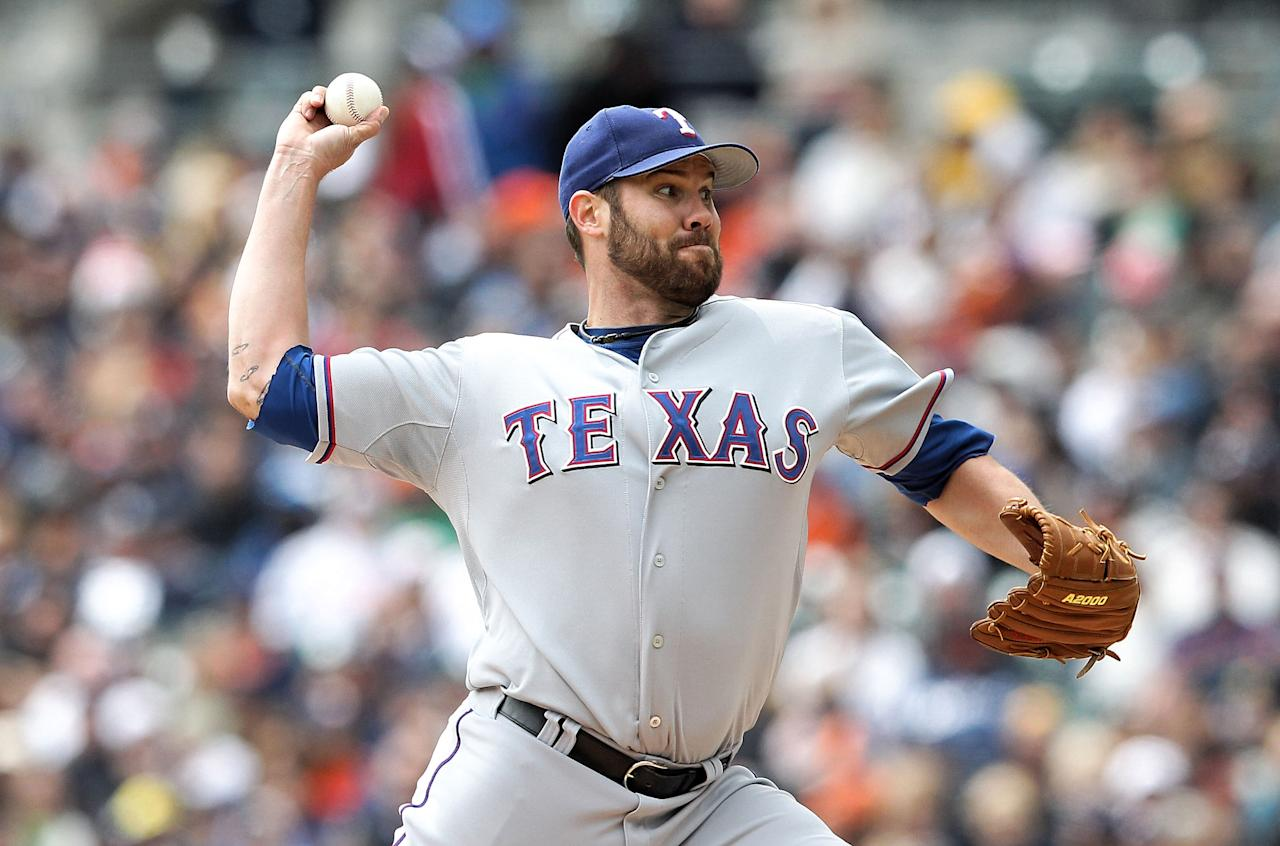 DETROIT, MI - APRIL 22: Colby Lewis #48 of the Texas Rangers pitches in the first inning during the game against the Detroit Tigers at Comerica Park on April 22, 2012 in Detroit, Michigan.  (Photo by Leon Halip/Getty Images)