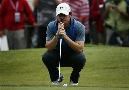 Northern Ireland's McIlroy leans on his putter on the eighth hole during the second round of the Australian Open golf tournament at Royal Sydney Golf Club