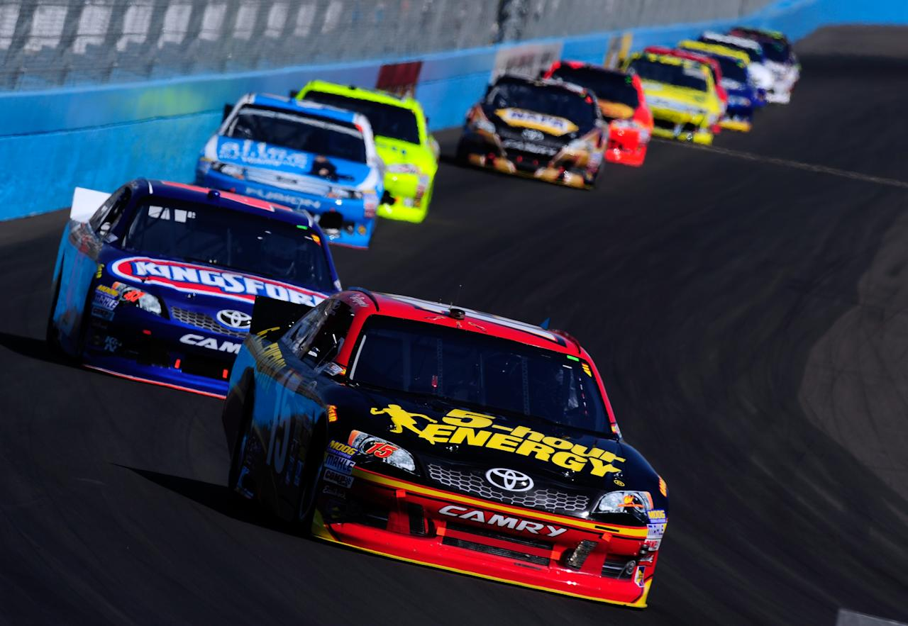 AVONDALE, AZ - MARCH 04:  Clint Bowyer, driver of the #15 5-hour Energy Toyota, drives ahead of a group of cars during the NASCAR Sprint Cup Series SUBWAY Fresh Fit 500 at Phoenix International Raceway on March 4, 2012 in Avondale, Arizona.  (Photo by Robert Laberge/Getty Images for NASCAR)