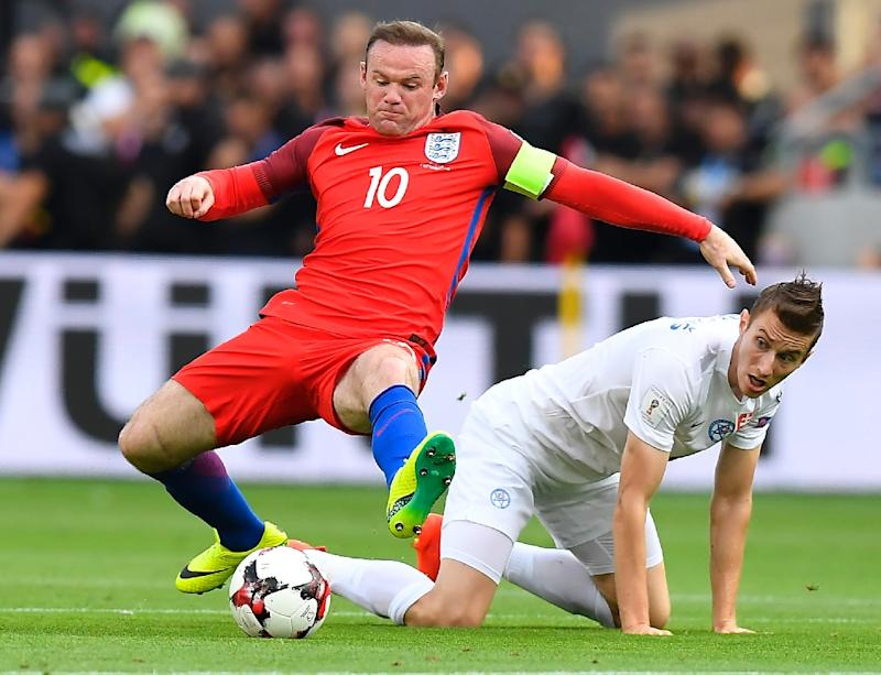 England's Wayne Rooney (L) adopted a deep-lying midfield role for much of the game against Slovakia