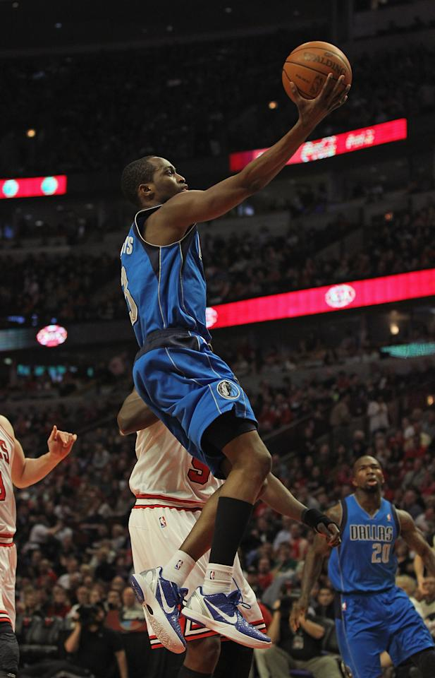 CHICAGO, IL - APRIL 21: Rodrigue Beaubois #3 of the Dallas Mavericks lays in a shot past Loul Deng #9 of the Chicago Bulls at the United Center on April 21, 2012 in Chicago, Illinois. NOTE TO USER: User expressly acknowledges and agress that, by downloading and/or using this photograph, User is consenting to the terms and conditions of the Getty Images License Agreement.  (Photo by Jonathan Daniel/Getty Images)