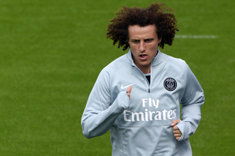 Paris Saint-Germain's newly recruited Brazilian defender David Luiz runs during a training session on August 7, 2014 at the club's Camp des Loges training centre in Saint-Germain-en-Laye, west of Paris