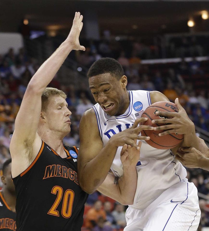 Duke forward Jabari Parker (1) works against Mercer forward Jakob Gollon (20) during the first half of an NCAA college basketball second-round game, Friday, March 21, 2014, in Raleigh, N.C. (AP Photo/Gerry Broome)