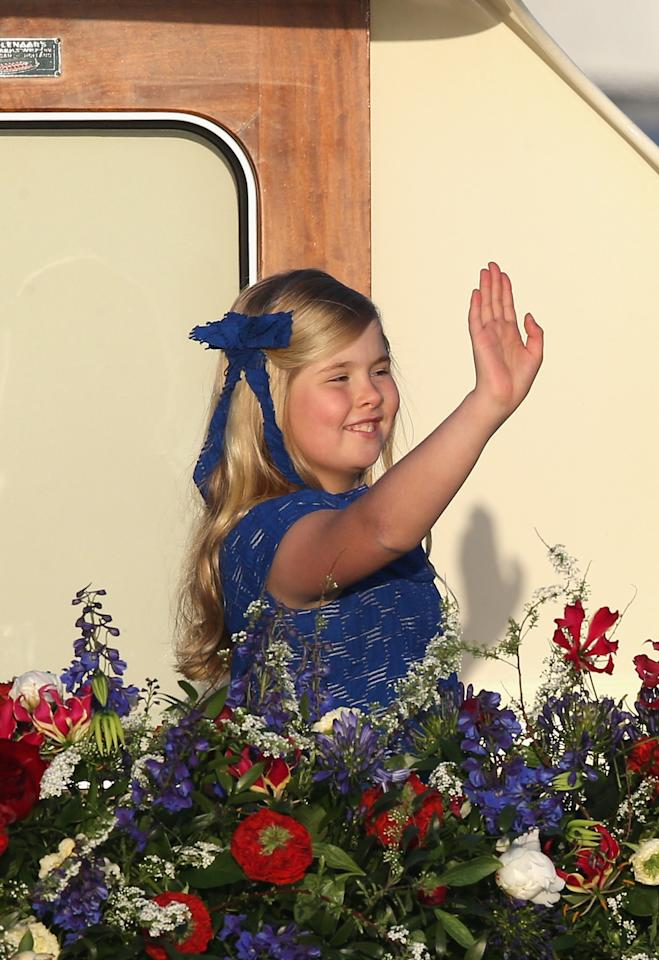 AMSTERDAM, NETHERLANDS - APRIL 30:  Princess Catharina-Amalia is seen aboard the King's boat for the water pageant to celebrate the inauguration of King Willem Alexander of the Netherlands after the abdication of his mother Queen Beatrix of the Netherlands on April 30, 2013 in Amsterdam, Netherlands.  (Photo by Chris Jackson/Getty Images)