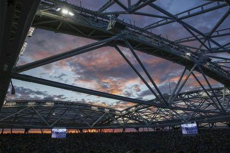 Arthur Ashe Stadium is seen at sunset ahead of the mens final between Roger Federer of Switzerland and Novak Djokovic of Serbia at the U.S. Open Championships tennis tournament in New York, in this file photo dated September 13, 2015.   REUTERS/Lucas Jackson