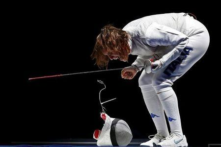 Italy's Arianna Errigo celebrates the victory over team Russia in the women's team foil final at the World Fencing Championships in Moscow, Russia, July 19, 2015.  REUTERS/Grigory Dukor