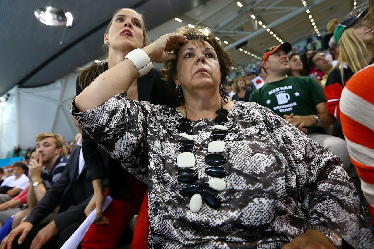 LONDON, ENGLAND - AUGUST 02:  Debbie Phelps (R) the mother of Michael Phelps of the United States and his sisterHilary Phelps (L) cheer him on as he competes in gold the Men's 200m Individual Medley final on Day 6 of the London 2012 Olympic Games at the Aquatics Centre on August 2, 2012 in London, England.  (Photo by Al Bello/Getty Images)