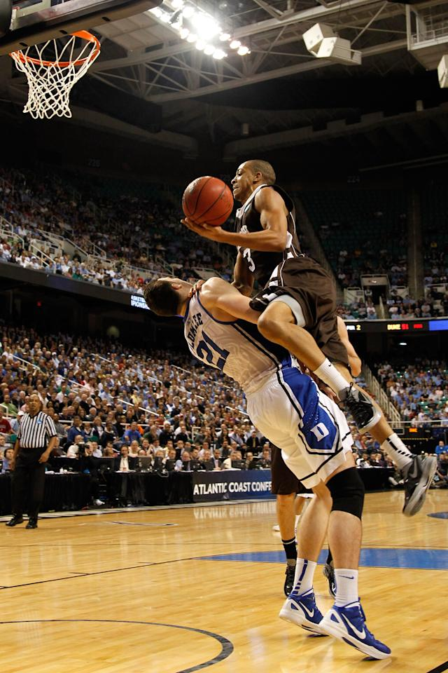 GREENSBORO, NC - MARCH 16:  C.J. McCollum #3 of the Lehigh Mountain Hawks goes up for a shot against Miles Plumlee #21 of the Duke Blue Devils during the second round of the 2012 NCAA Men's Basketball Tournament at Greensboro Coliseum on March 16, 2012 in Greensboro, North Carolina.  (Photo by Mike Ehrmann/Getty Images)