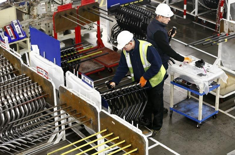 Workers inspect components on the fuel inlet production facility in Foston