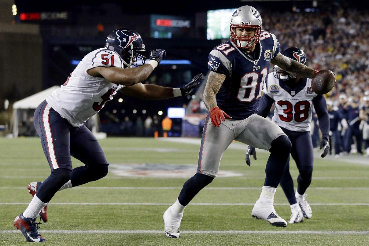 New England Patriots tight end Aaron Hernandez (81) crosses the goal line after a reception for a touchdown in front of Houston Texans inside linebacker Darryl Sharpton (51) and free safety Danieal Manning (38) during the second quarter of an NFL football game in Foxborough, Mass., Monday, Dec. 10, 2012. (AP Photo/Elise Amendola)