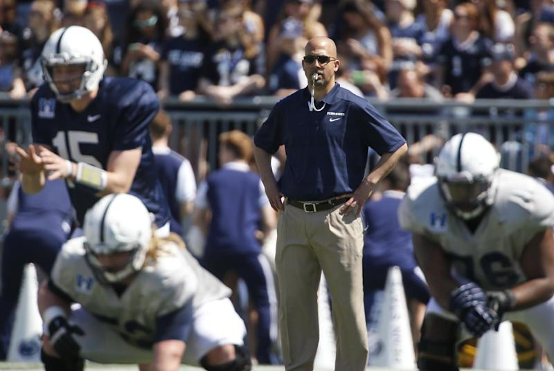 In this April 12, 2014, photo, Penn State coach James Franklin watches the NCAA college football team's annual Blue-White spring scrimmagein State College, Pa. Franklin is trying to inject Penn State with the enthusiasm he brought to Vanderbilt