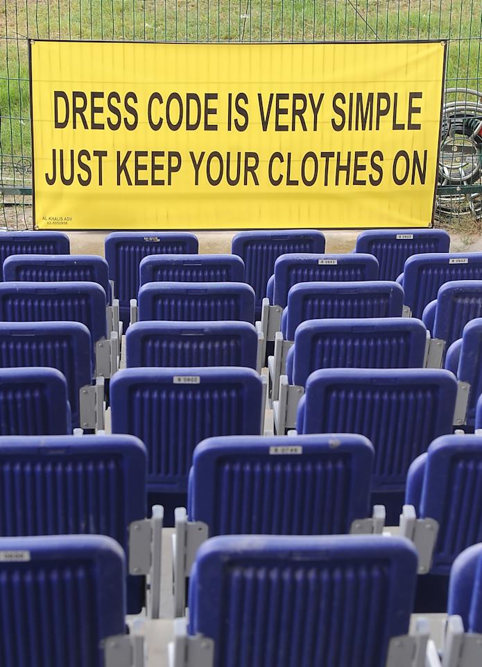 A warning sign is displayed at the Sheikh Zayed Stadium in Abu Dhabi on January 24, 2012. The Barmy Army fans will not be allowed to pull off their tops while watching the second cricket Test between Pakistan and England starting here from January 25. AFP PHOTO/Lakruwan WANNIARACHCHI (Photo credit should read LAKRUWAN WANNIARACHCHI/AFP/Getty Images)