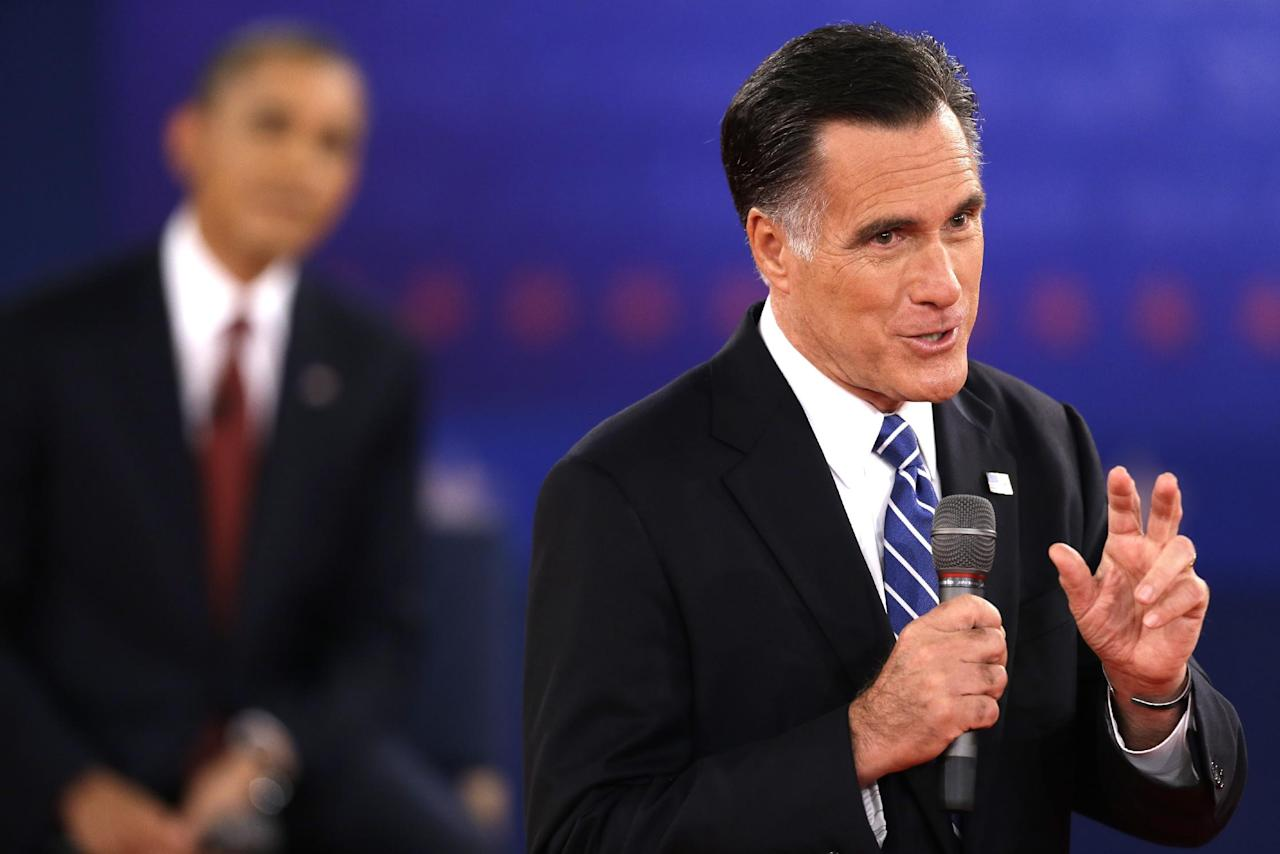 Republican presidential nominee Mitt Romney speaks while President Barack Obama listens during the second presidential debate at Hofstra University, Tuesday, Oct. 16, 2012, in Hempstead, N.Y. (AP Photo/David Goldman)