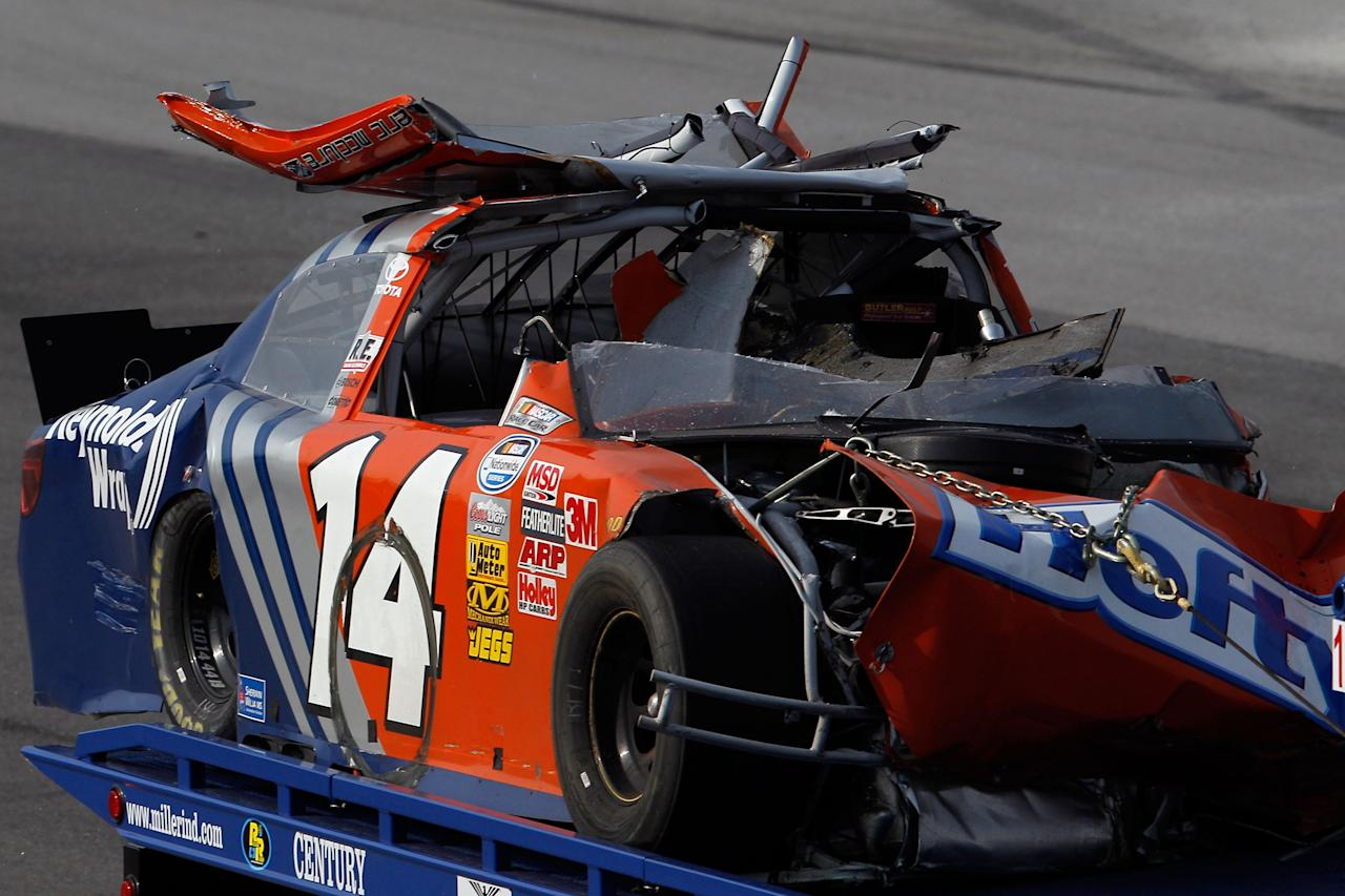 TALLADEGA, AL - MAY 05:  The #14 Hefty/Reynolds Wrap Toyota of Eric McClure is removed from the track during the NASCAR Nationwide Series Aaron's 312 at Talladega Superspeedway on May 5, 2012 in Talladega, Alabama.  (Photo by Chris Graythen/Getty Images for NASCAR)