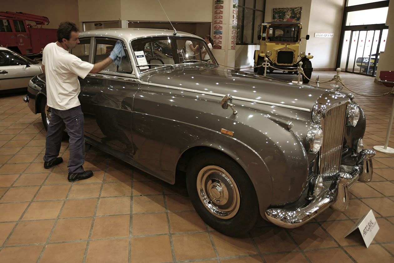 A worker cleans a 1956 Bentley S1 from the collection of Prince Albert II of Monaco at the Automobile Museum in Monaco.