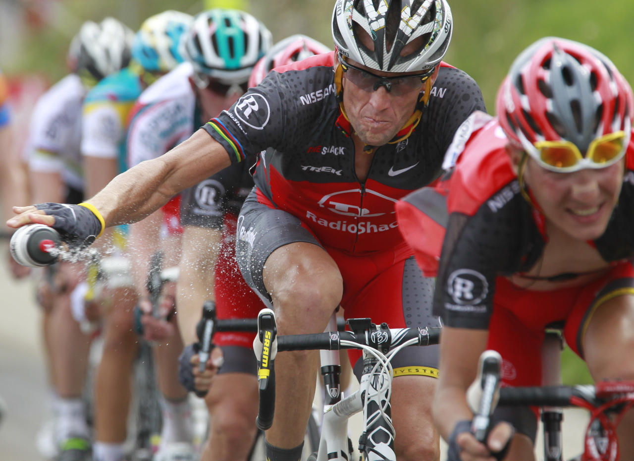 FILE - In this July 10, 2010, file photo, Lance Armstrong throws out his water bottle in the last kilometers of the climb toward Station les Rousses, France, during the seventh stage of the Tour de France cycling race. The New York Times reported Friday, Jan. 4, 2013, that Armstrong, who has strongly denied the doping charges that led to him being stripped of his seven Tour de France titles, has told associates he is considering admitting to the use of performance-enhancing drugs. Armstrong attorney Tim Herman denied that Armstrong has reached out to USADA chief executive Travis Tygart and David Howman, director general of the World Anti-Doping Agency. (AP Photo/Bas Czerwinski, File)