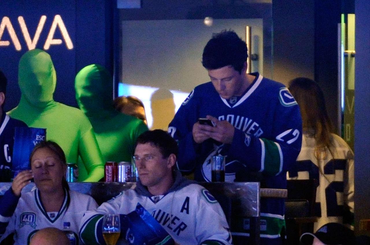 VANCOUVER, CANADA - MAY 15:  Actor Cory Monteith of Glee checks his mobile phone during the game between the San Jose Sharks and the Vancouver Canucks during Game One of the Western Conference Finals during the 2011 Stanley Cup Playoffs at Rogers Arena on May 15, 2011 in Vancouver, British Columbia, Canada. The Canucks defeated the Sharks 3-2.  (Photo by Rich Lam/Getty Images)