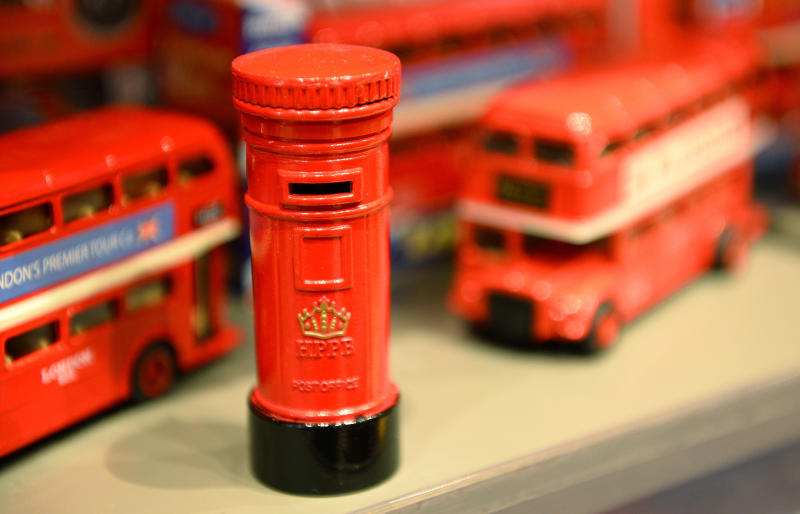 Toy post box and London buses are seen on sale in central London