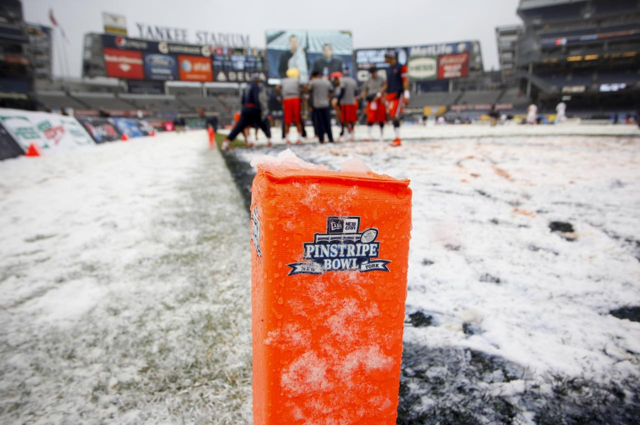 NEW YORK, NY - DECEMBER 29:  Snow covers a goal marker before the New Era Pinstripe Bowl between West Virginia Mountaineers and the Syracuse Orange at Yankee Stadium on December 29, 2012 in the Bronx borough of New York City.  (Photo by Jeff Zelevansky/Getty Images)