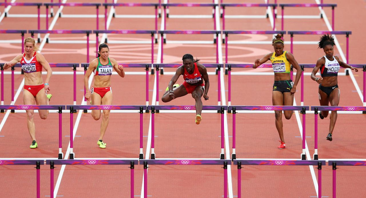 LONDON, ENGLAND - AUGUST 07:  Dawn Harper of the United States leads the pack in the Women's 100m Hurdles Semifinals on Day 11 of the London 2012 Olympic Games at Olympic Stadium on August 7, 2012 in London, England.  (Photo by Cameron Spencer/Getty Images)